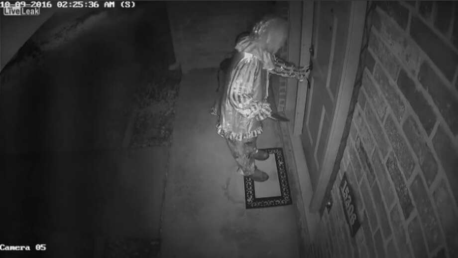 """The exact origin of the video is unclear, but LiveLeak user """"IceColdTexan1964"""" said he checked his surveillance footage after waking up and noticing his gate was open and found a """"creepy clown"""" lurking the property. Photo: LiveLeak.com/IceColdTexan1964"""