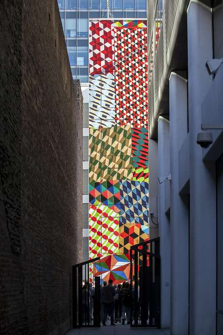 Barry McGee's six-story mural on the Moscone Center Garage is framed by an alley across from the new Howard Street entrance to the S.F. Museum of Modern Art. Photo: Santiago Mejia, Special To The Chronicle