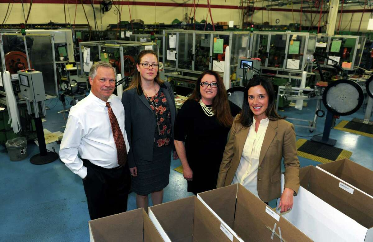 Bead Industries in Milford. From left to right is Chairman of the Board Ken Bryant, and his daughters: Database Manager Sylvia Pessin, Senior Marketing Manager Leah Davenport, and President Jill Mayer. Bead Industries is being inducted into the HCC American Manufacturing Hall of Fame.
