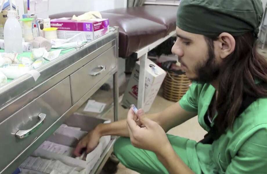 A doctor checks supplies last week at a hospital in Aleppo, Syria. Only 35 doctors remain in the area. Photo: Uncredited, Associated Press