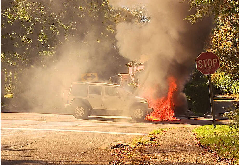 A car burst into flames Monday afternoon after two vehicles collided at the intersection of West Rocks Road and Bayne Street. Photo: Harold F. Cobin