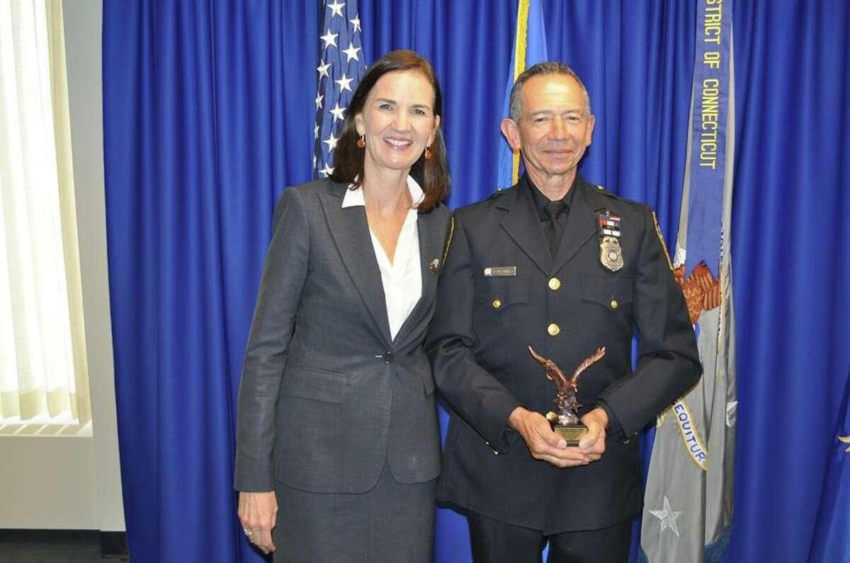 U.S. Attorney Deirdre Daly with Officer Cesar Ramirez.