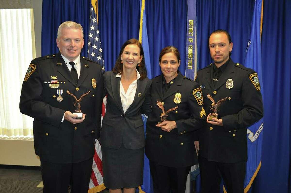 Lt. Terrence Blake, U.S. Attorney Deirdre Daly, Sgt. Sofia Gulino and Officer Felipe Taborda.