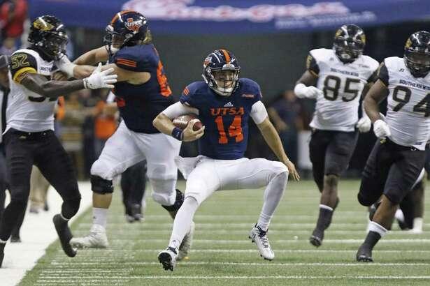 UTSA quarterback Dalton Sturm runs against Southern Miss at the Alamodome on Oct. 8, 2016, in San Antonio.