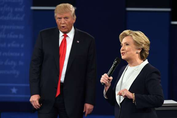 TOPSHOT - US Democratic presidential candidate Hillary Clinton and US Republican presidential candidate Donald Trump debate during the second presidential debate at Washington University in St. Louis, Missouri, on October 9, 2016. / AFP PHOTO / Robyn BeckROBYN BECK/AFP/Getty Images