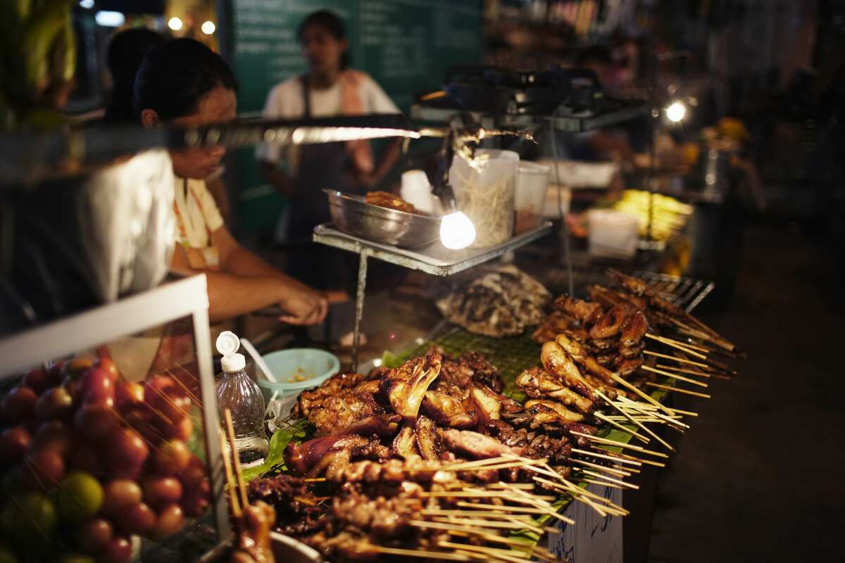 Thailand-style night market food stands. Imagine you walk out of a bar at the end of a night, and there's a food stall dishing up smokey skewers of meat, piles of vegetable stir-fry, bowls of steaming noodle soups. Yes, bacon-wrapped hot dogs can hit the spot, but more interesting, inventive options for street-side late-night cuisine would be greatly appreciated.