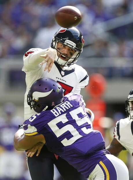 Houston Texans quarterback Brock Osweiler (17) is hit by Minnesota Vikings outside linebacker Anthony Barr (55), forcing an incomplete pass, during the second quarter of an NFL football game at U.S. Bank Stadium on Sunday, Oct. 9, 2016, in Minneapolis. ( Brett Coomer / Houston Chronicle ) Photo: Brett Coomer/Houston Chronicle