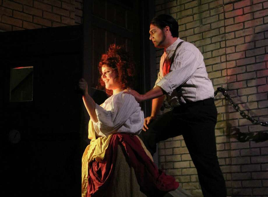 "Sara Brooks (front) and Roy Bumgarner star in the Woodlawn Theatre's staging of ""Sweeney Todd."" Photo: Courtesy Woodlawn Theatre / Courtesy Woodlawn Theatre"