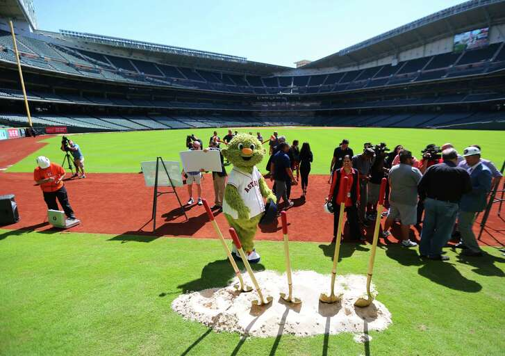 Orbit jokes around on Tal's Hill following a groundbreaking ceremony at Minute Maid Park that will include the destruction of the unique outfield obstacle, Monday, Oct. 10, 2016, in Houston.