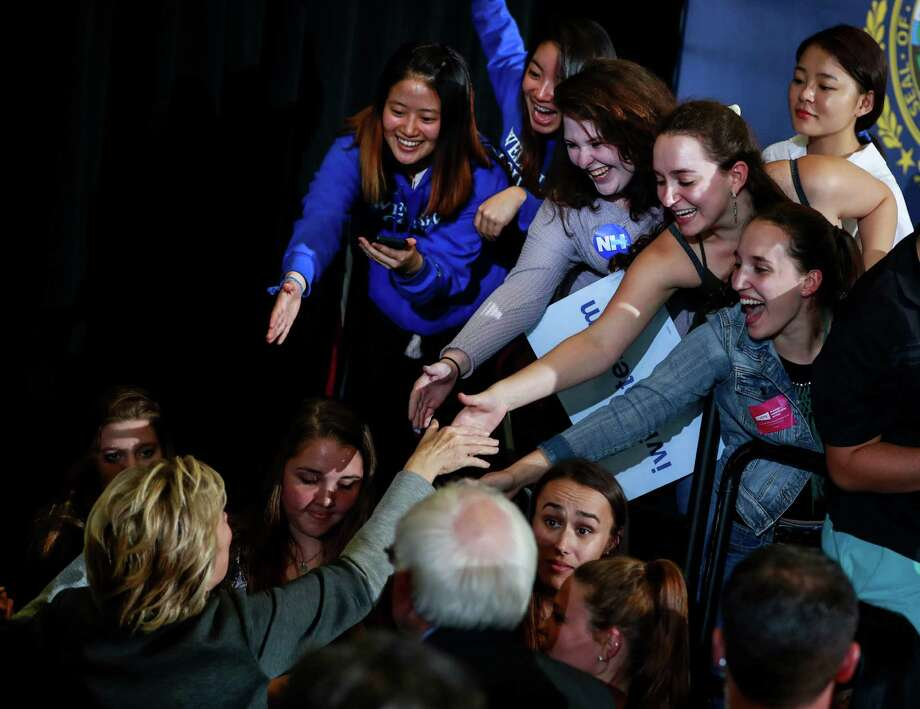 Sen. Bernie Sanders (I-Vt.) and Hillary Clinton greet students at a recent campaign event at the University of New Hampshire in Durham, N.H. For Clinton, appearing with Sanders is an effort to energize the senator's base of millennial voters who do not seem to have warmed to her. Photo: DOUG MILLS /NYT / NYTNS