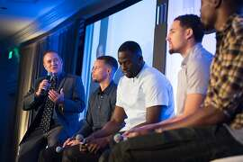 Bob Fitzgerald, left, speaks with Warriors team members during the Tip-Off Luncheon in San Francisco, Calif. on Monday, Oct. 10, 2016. Steve Kerr and the warriors met some of the city's top officials during a luncheon at the Ritz Carlton.