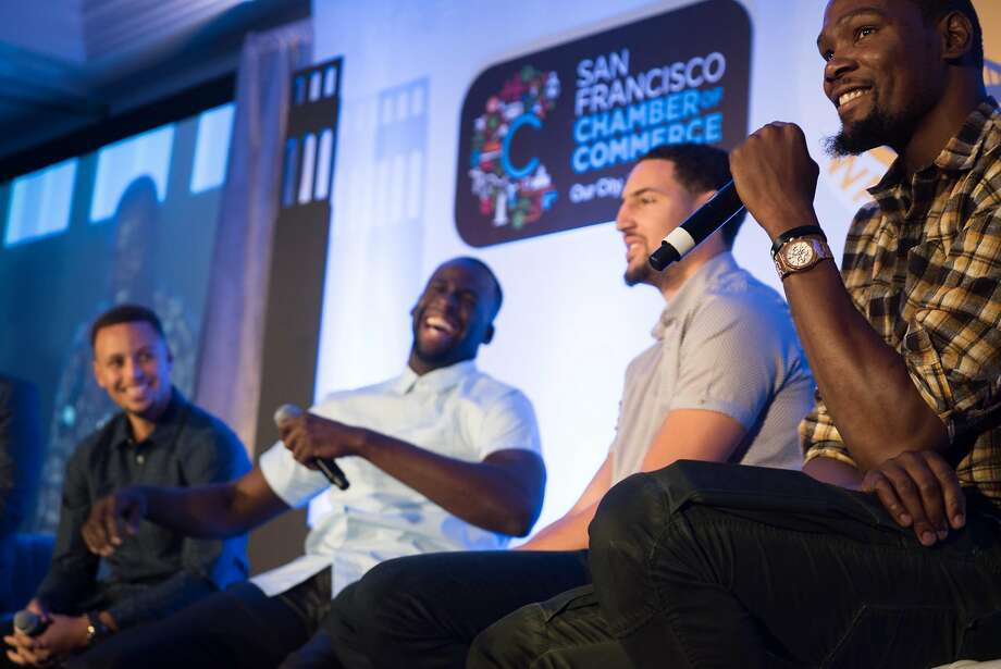 Kevin Durant (right to left) speaks and Warriors teammates Klay Thompson, Draymond Green and Stephen Curry share the stage at the Warriors Tip-Off Luncheon on Monday at the Ritz Carlton. Photo: James Tensuan, Special To The Chronicle
