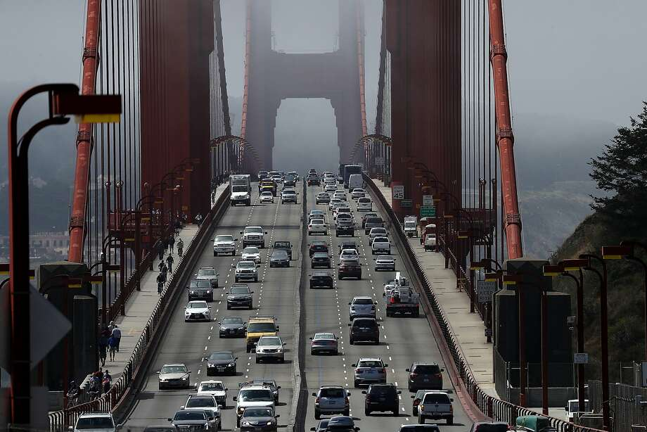 Cars drive over the Golden Gate Bridge on June 28. Police over the weekend responded to reports of motorcyclists pulling stunts on the bridge. Photo: Justin Sullivan, Getty Images