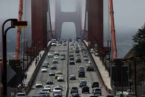SAUSALITO, CA - JUNE 28:  Cars drive over the Golden Gate Bridge on June 28, 2016 in Sausalito, California. A new video that allegedly supports ISIL has emerged on the internet shows San Francisco's iconic Golden Gate Bridge as well as the office building at 555 California.  (Photo by Justin Sullivan/Getty Images)