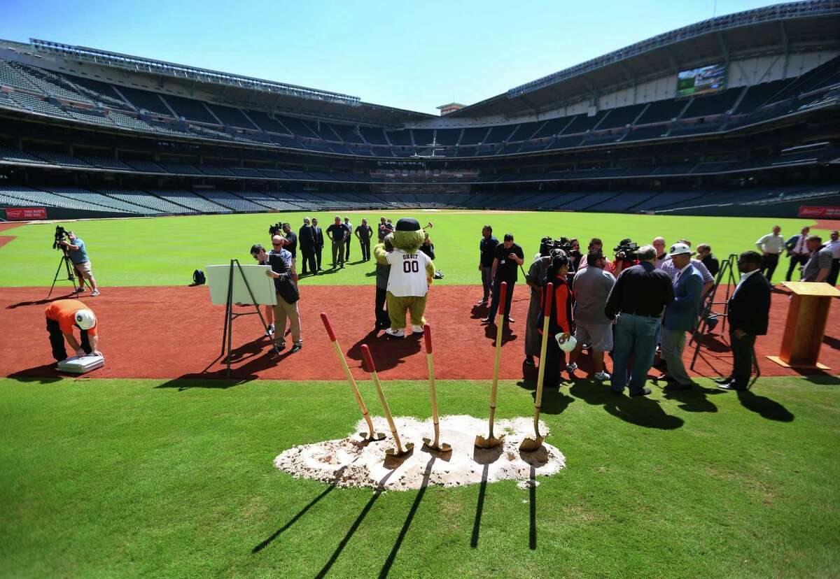 Orbit poses for pictures on Tal's Hill following a groundbreaking ceremony at Minute Maid Park that will include the destruction of the unique outfield obstacle, Monday, Oct. 10, 2016, in Houston.