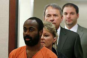 """Chimene Hamilton Onyeri is led into the courtroom for a bond hearing on a murder charge in Judge Jan Krocker's 184th State District Court Wednesday, Jan. 6, 2016, in Houston. Onyeri is also a """"person of interest"""" in the shooting of an Austin judge last year.  ( James Nielsen / Houston Chronicle )"""