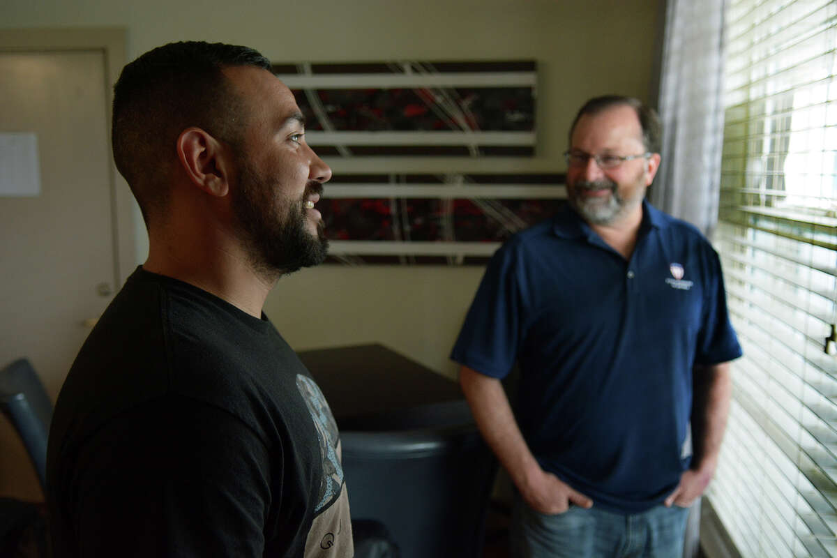 Veteran Josh Castro, left, of Sacramento, CA. and a resident of Camp Hope, visits with Executive Director David Maulsby in the interim housing area of the camp on June 23, 2016. (Photo by Jerry Baker/Freelance)
