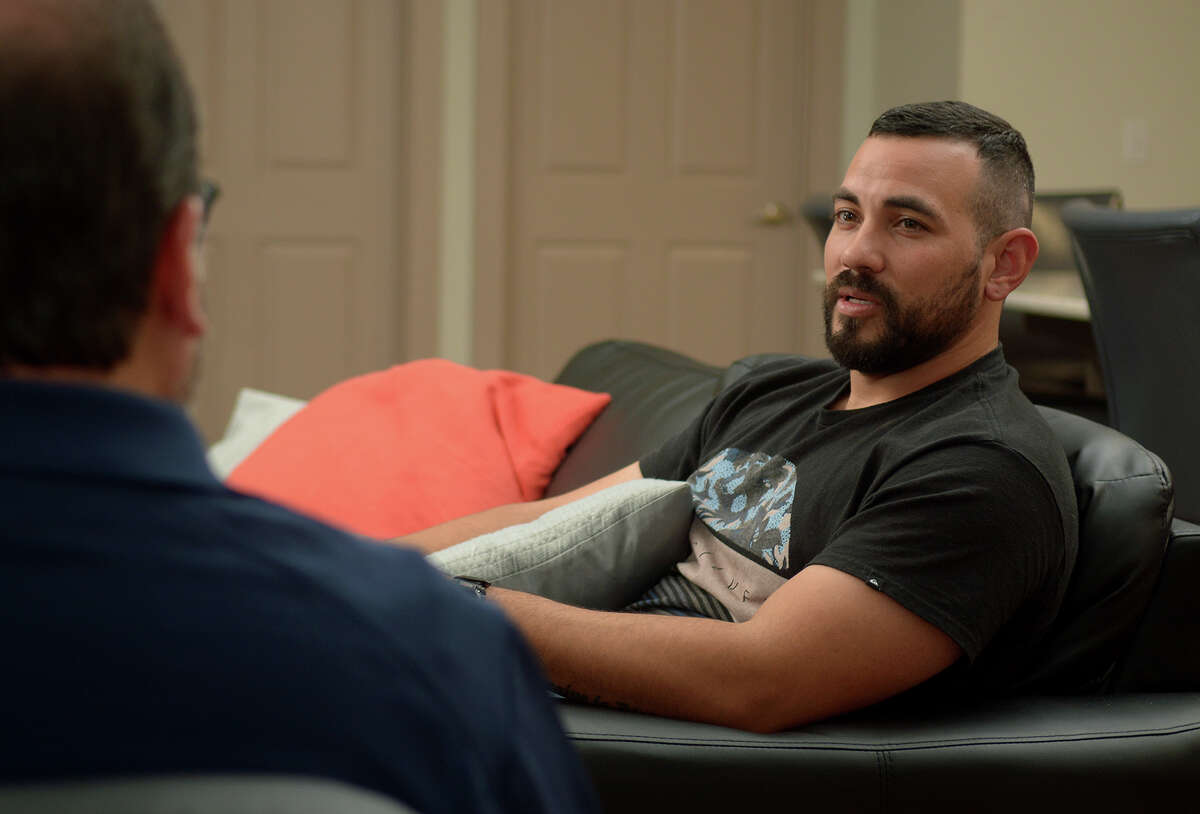 Veteran Josh Castro, of Sacramento, CA. and a resident of Camp Hope, visits with Executive Director David Maulsby in the interim housing area of the camp on June 23, 2016. (Photo by Jerry Baker/Freelance)