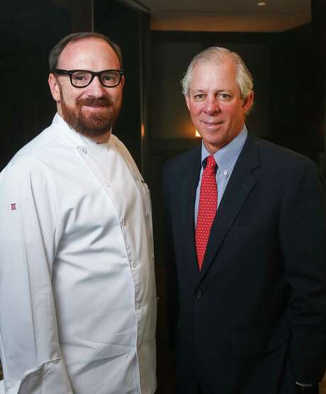 Chef Jon Buchanan, left, and Dr. Robert Robbins, president and CEO of the Texas Medical Center, pose for a portrait at Trevisio, Wednesday, Sept. 28, 2016, in Houston.  ( Jon Shapley / Houston Chronicle ) Photo: Jon Shapley, Staff / © 2015  Houston Chronicle