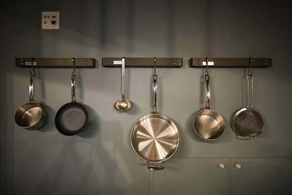 Pots hang in a classroom's kitchen in the new Culinary Institute of America in Napa, California, October 10th,2016.  The Culinary Institute of America, which is headquartered in Hyde Park, NY but has a branch in St. Helena, is taking over the former Copia museum in Napa for its first cooking school, museum and event space oriented toward home cooks. Closed since 2008, the new CIA at Copia will open in November for cooking classes, a restaurant and wine tastings and will later open its museum devoted to Chuck Williams� personal cookware collection.