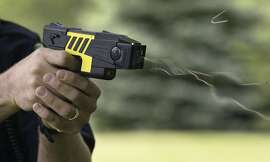 The use of the is M26 Advanced Taser is demonstrated by the Marion Police Department, Tuesday, June 7, 2004, in Marion, Iowa. The non-lethal force weapon uses Electro-Muscular Disruption to override the central nervous system. A 50,000 volt, 26-watt charge causes an uncontrollable contraction of muscle tissue. A normal hit from the Taser lasts for five seconds. The time allows officers to subdue the subject before that person can recover. (AP Photo/The Gazette, Jim Slosiarek)