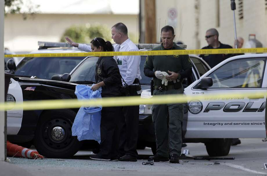 Los Angeles County Sheriff's homicide detectives help police investigate an officer-involved shooting that occurred at the end of a car pursuit in Glendale in March. The suspect was killed. Photo: Nick Ut, AP