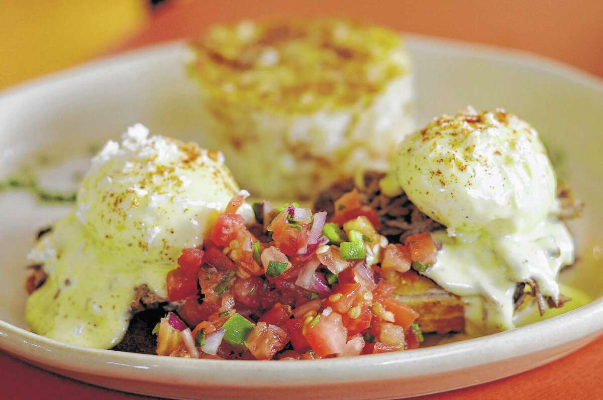 The Chilaquiles Benedict at Snooze on Montrose.