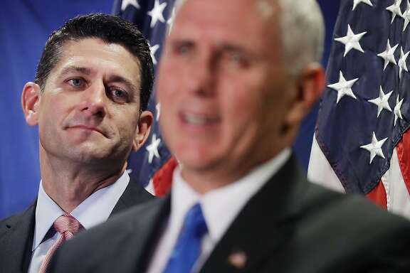WASHINGTON, DC - SEPTEMBER 13:  Speaker of the House Paul Ryan (R-WI) (L) listens to U.S. Republican vice presidental nominee Gov. Mike Pence during a news conference following a weekly House GOP conference at the Republican headquaters on Capitol Hill September 13, 2016 in Washington, DC. When asked about former vice presidential candidate Ryan's reluctance to endorse presidential candidate Donald Trump, Pence said that the House Republicans and the campaign agree on a plan for America.  (Photo by Chip Somodevilla/Getty Images)