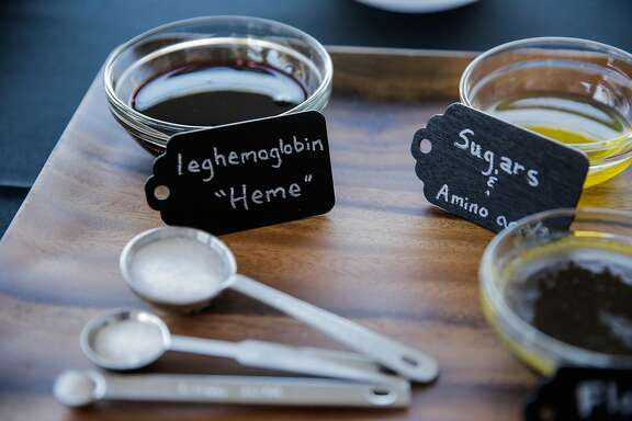 """Ingredients used to make non-meat burgers, including """"heme"""" or legehemoglobin, which comes from genetically engineered yeast cells, is seen on display at a press event at the Impossible Foods headquarters in Redwood City, California, on Thursday, Oct. 6, 2016. The """"heme"""" is supposed to be similar to that of animal blood."""