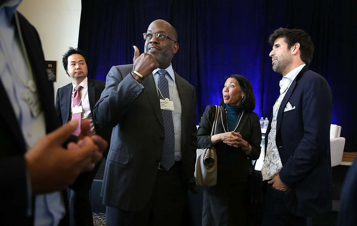 CEO Bernard Tyson (middle left) of Kaiser Foundation Health Plan, Inc., senior director of communications Donna Uchida (middle right) at Kaiser, and president Felix Marquardt (far right) of Cylance International attend The World Economic Forum for the Fourth Industrilal Revolution in the Presidio in the Presidio on Monday, October 10, 2016, in San Francisco, Calif.