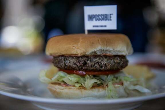 A non-meat burger made by Impossible Foods rests on a plate before being tasted, during a press event at the Impossible Foods headquarters in Redwood City, California, on Thursday, Oct. 6, 2016.