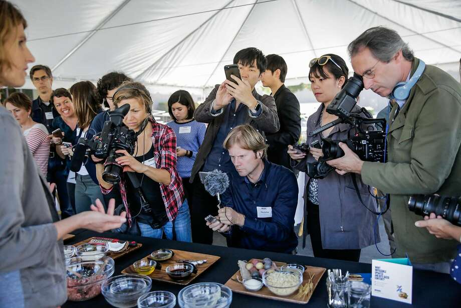 Members of the press photograph and take video as principal scientist Celeste Holz- Schietinger (left) speaks at a press event, introducing a non-meat burger, made by Impossible Foods, in Redwood City, California, on Thursday, Oct. 6, 2016. Photo: Gabrielle Lurie, The Chronicle