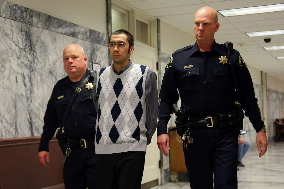Aaron Ybarra is escorted to the courtroom on the first day of his trial for allegedly opening fire at Seattle Pacific University in June 2014, killing one victim Paul Lee and injuring two others, Oct. 10, 2016. Photo: GENNA MARTIN, SEATTLEPI.COM / SEATTLEPI.COM