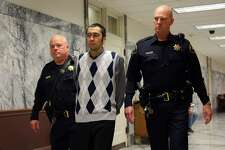 Aaron Ybarra is escorted to the courtroom on the first day of his trial for allegedly opening fire at Seattle Pacific University in June 2014, killing one victim Paul Lee and injuring two others, Oct. 10, 2016.