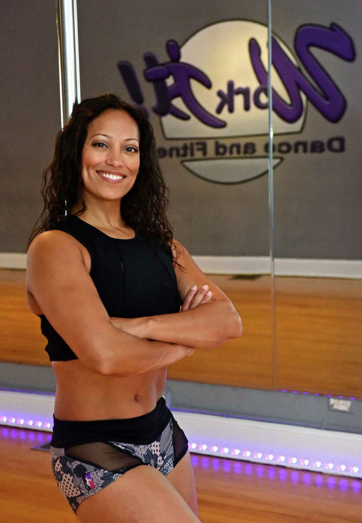 Norwalk resident and cancer survivor Michelle Abbruzzese, age 45, at her dance studio, Work It!, on North Main Street in Norwalk, Conn. Friday, October 7, 2016. Abbruzzese will be competing in the Northeast Pole Dancing Championships taking place in Stamford this weekend.