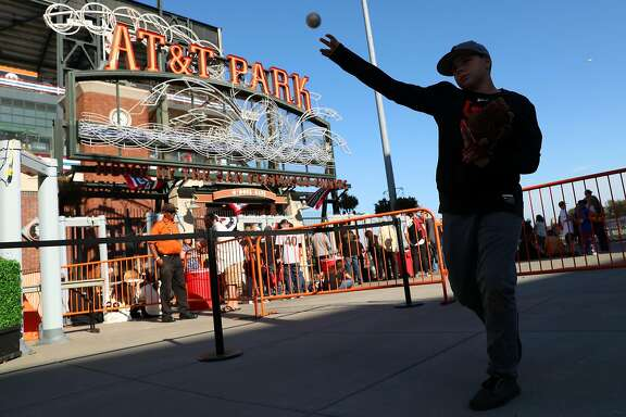 San Francisco Giants' fan Jonathan Knacke, 13, of Lincoln  plays catch outside AT&T Park before Giants play Chicago Cubs in Game 3 of the National League Division Series in San Francisco, Calif., on Monday, October 10, 2016.