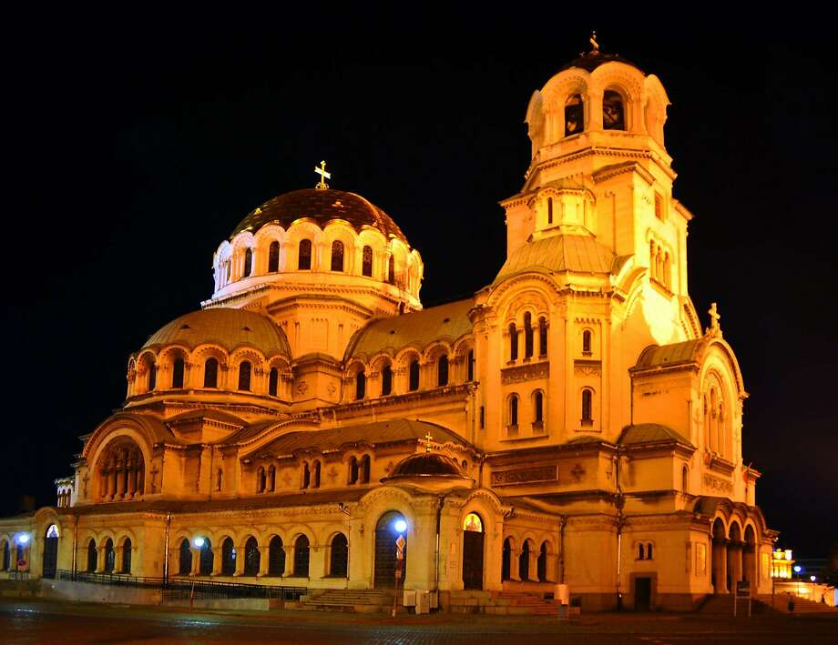 Sofia's Alexander Nevsky Cathedral, one of Christendom's largest Orthodox churches, glows at night. Photo: Cameron Hewitt