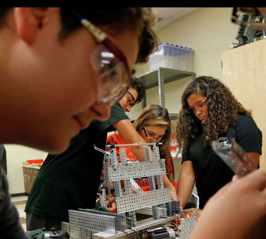 Maximus Bermmudez works with Carley Fell,C, and Cristela Jones on one of the robotics projects at STEM Early College High School on Thursday, October 5, 2016. In foreground is Tyler Tesson. Photo: Ron Cortes, Freelance / For The San Antonio Express-News