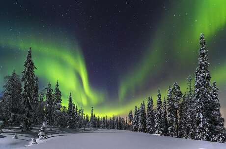 The northern lights dance over Pyha-Uosto National Park in Finland.