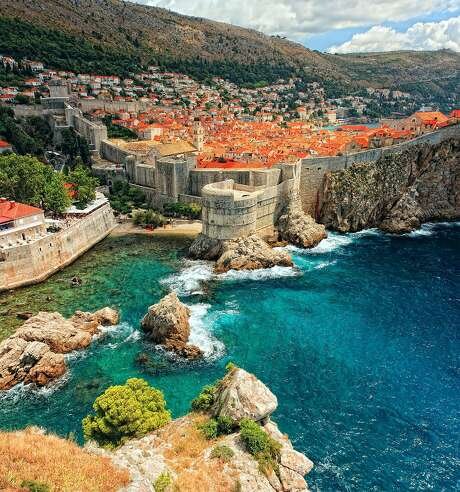 The ramparts of Dubrovnik's intimidating Old Town overlook the Adriatic Sea. Photo: Tridland/Getty Images/iStockphoto, Tridland/Getty Images/iStockpho