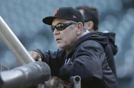 San Francisco Giants manager Bruce Bochy watches batting practice before Game 3 of baseball's National League Division Series against the Chicago Cubs in San Francisco, Monday, Oct. 10, 2016. (AP Photo/Ben Margot)