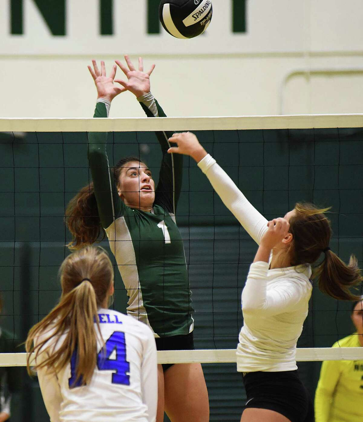Norwalk's Edona Jakaj, center, looks to block Bunnell's Gabby Shannon, right, as the Bulldogs' Katie Boyle looks on during Monday's game at Scarso Gym in Norwalk.