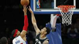 Detroit Pistons forward Tobias Harris (34) drives on San Antonio Spurs guard Danny Green (14) in the first half of a preseason NBA basketball game in Auburn Hills, Mich., Monday, Oct. 10, 2016. (AP Photo/Paul Sancya)