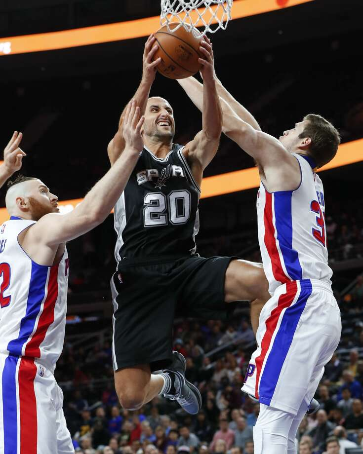 San Antonio Spurs guard Manu Ginobili (20) drives on Detroit Pistons forward Aron Baynes (12) and Jon Leuer (30) in the first half of a preseason NBA basketball game in Auburn Hills, Mich., Monday, Oct. 10, 2016. (AP Photo/Paul Sancya) Photo: Paul Sancya/Associated Press