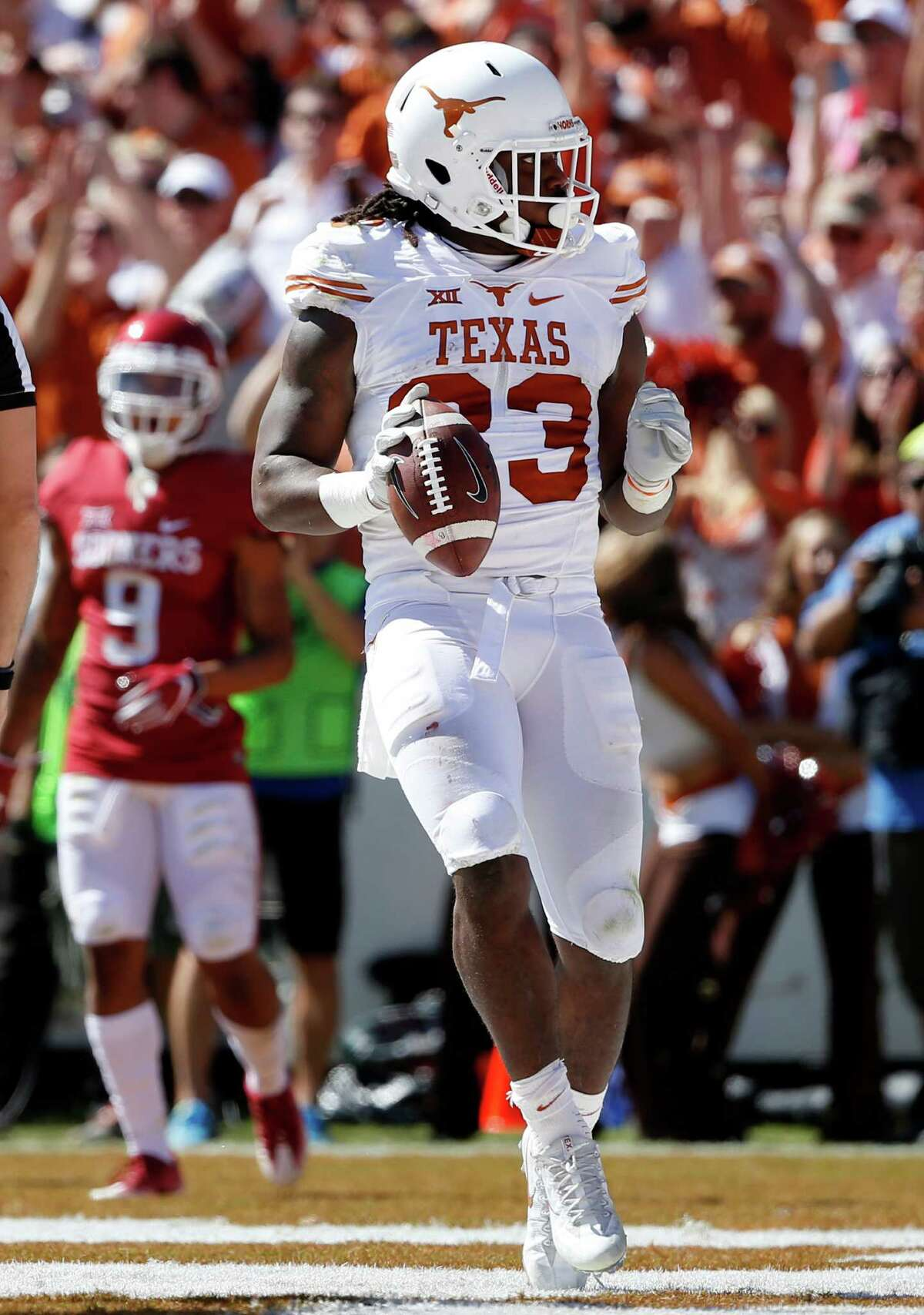 Texas running back D'Onta Foreman scores a touch-down against Oklahoma as part of a 159-yard game that was overshadowed by another poor defensive performance that led to a third consecutive loss.