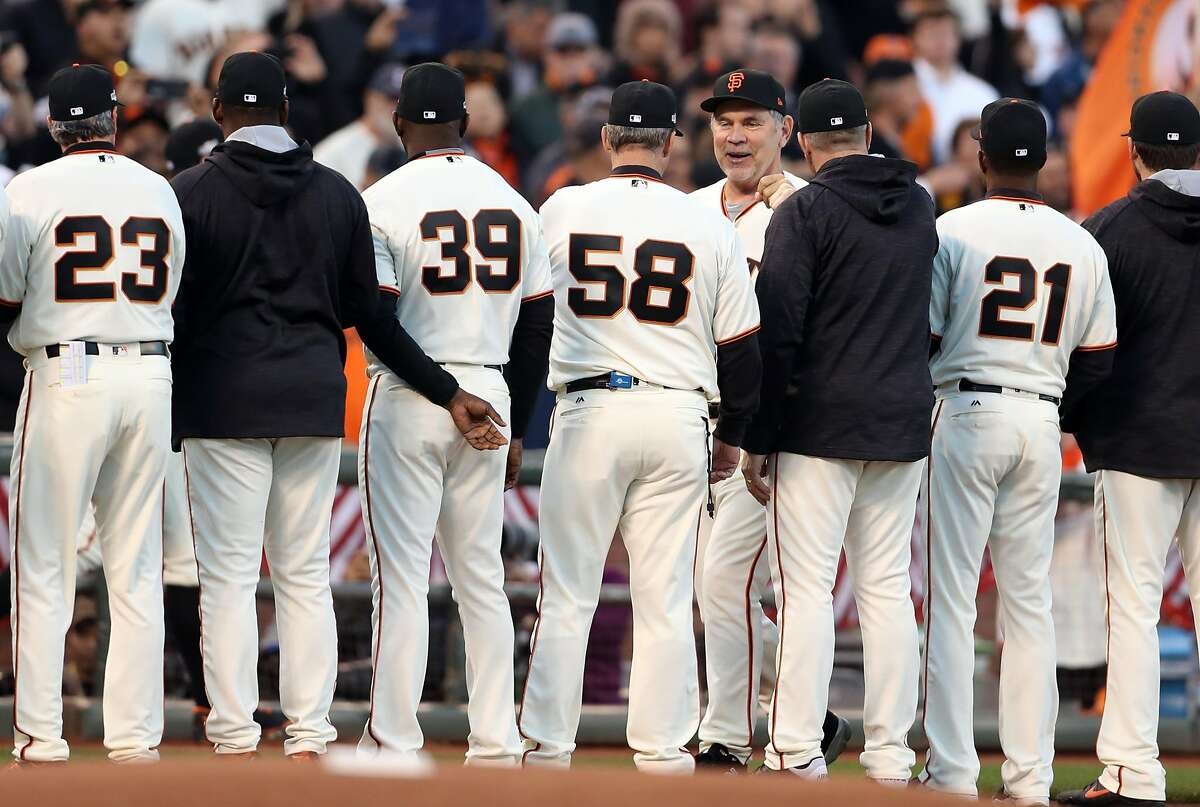 San Francisco Giants' manager Bruce Bochy greets his staff while being introduced before playing Chicago Cubs during Game 3 of the National League Division Series at AT&T Park in San Francisco, Calif., on Monday, October 10, 2016.
