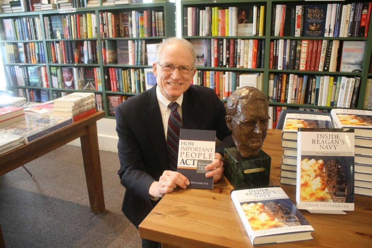 """Chase Untermeyer served as head of George H.W. Bush's White House personnel office (and worked for two other presidents as well). He's shown here with his 2016 book """"How Important People Act: Behaving Yourself in Public."""""""