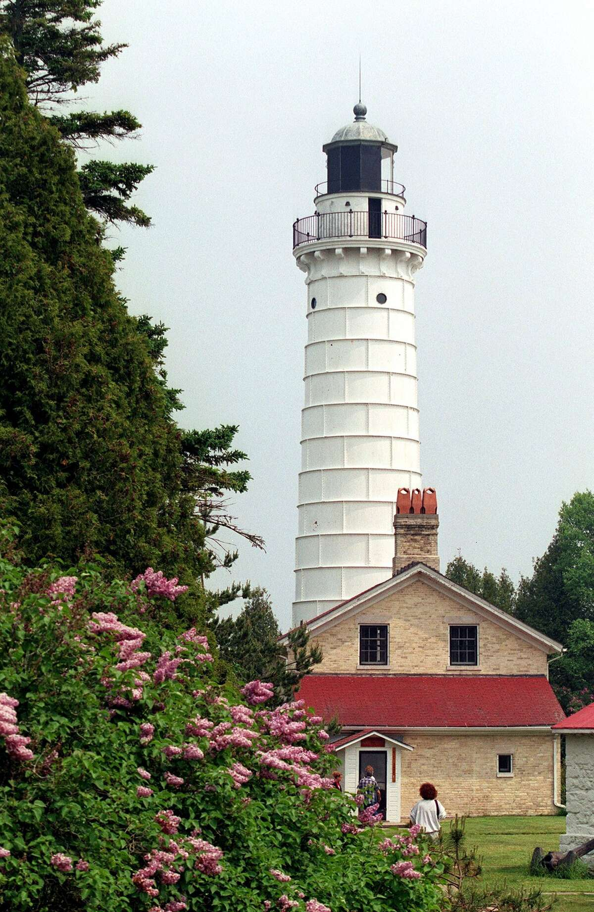 The Door County Peninsula has 10 lighthouses, including the Cana Island Lighthouse, built in 1869. PHOTOGRAPH BY TOM UHLENBROCK/ST. LOUIS POST-DISPATCH