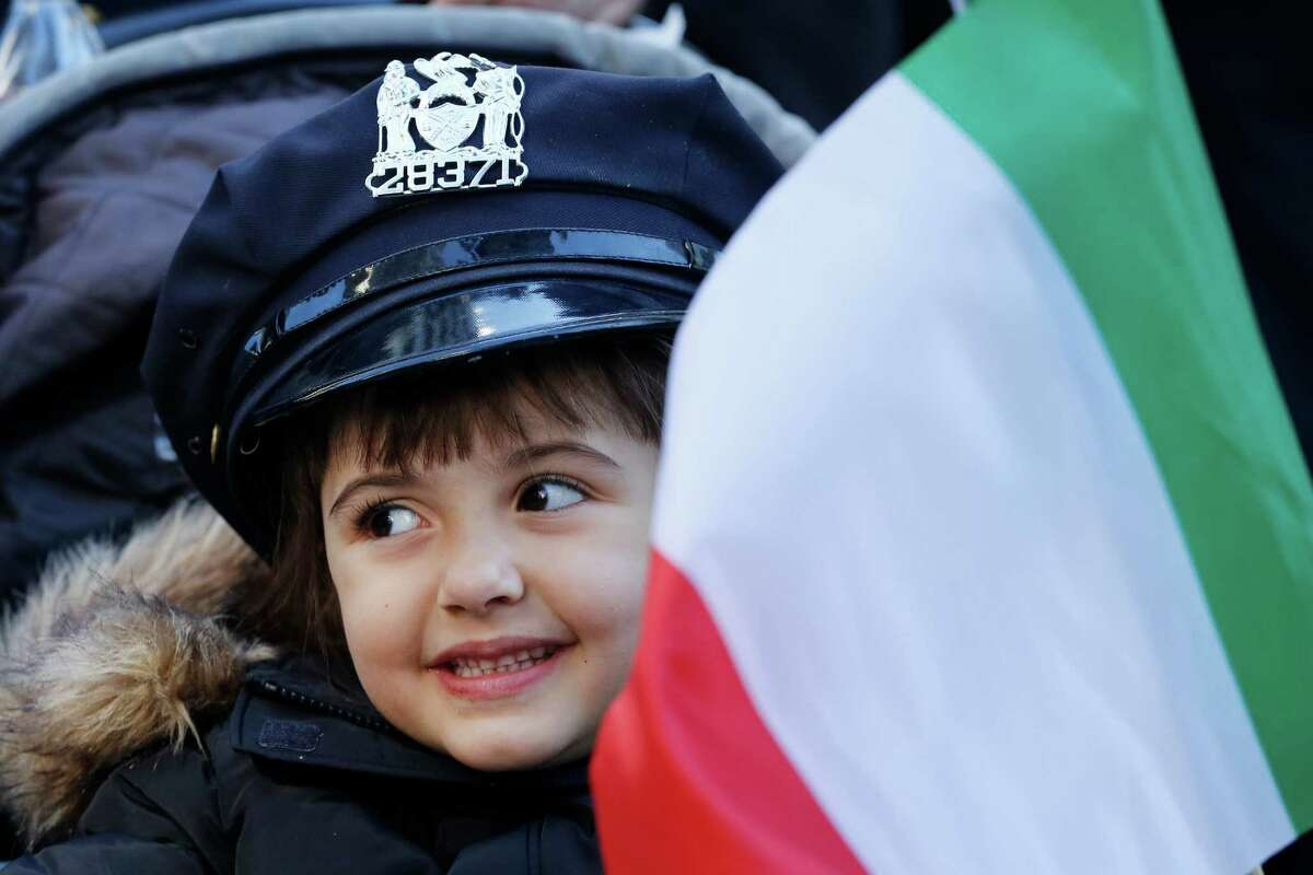 Annabella Riziezzo, 5, of East Islip, N.Y. marches in the Columbus Day Parade, Monday, Oct. 10, 2016, in New York City. (AP Photo/Mark Lennihan)