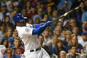 Chicago Cubs' Jorge Soler swings on a two-run home run during the second inning against the Milwaukee Brewers in a baseball game Thursday, Sept. 15, 2016, in Chicago. The Brewers won 5-4. (Joe Lewnard/Daily Herald via AP)
